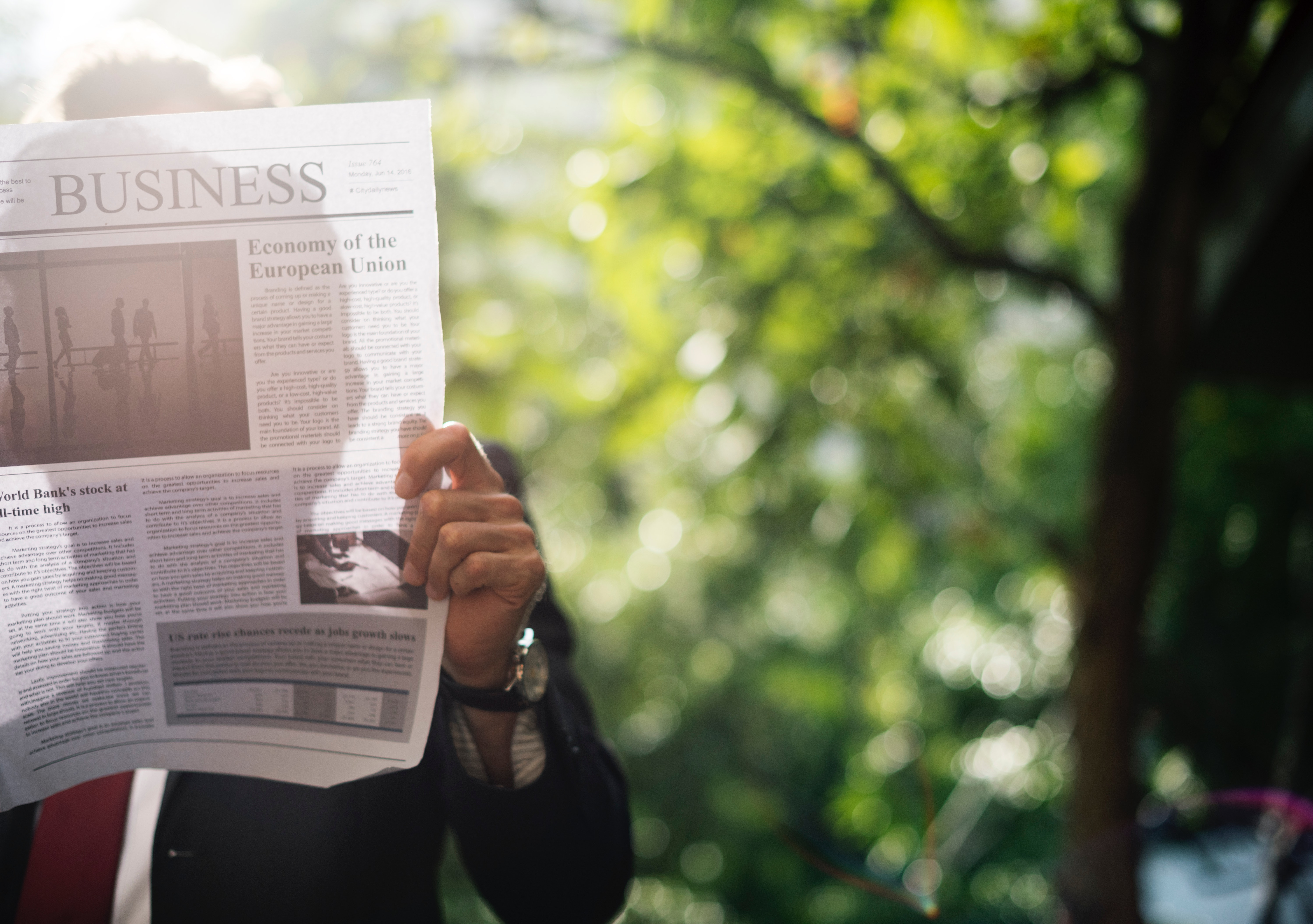Man reading a newspaper. Utilize news articles in your Business English Course